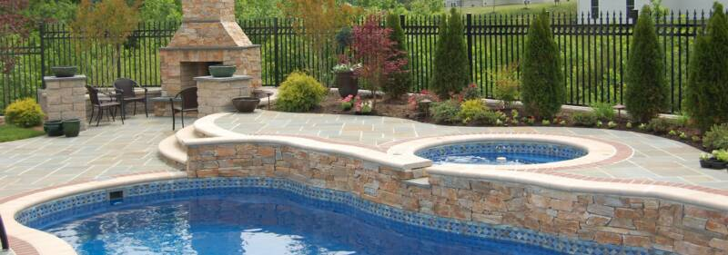 Bluestone pool deck with stone fireplace for Pool design virginia